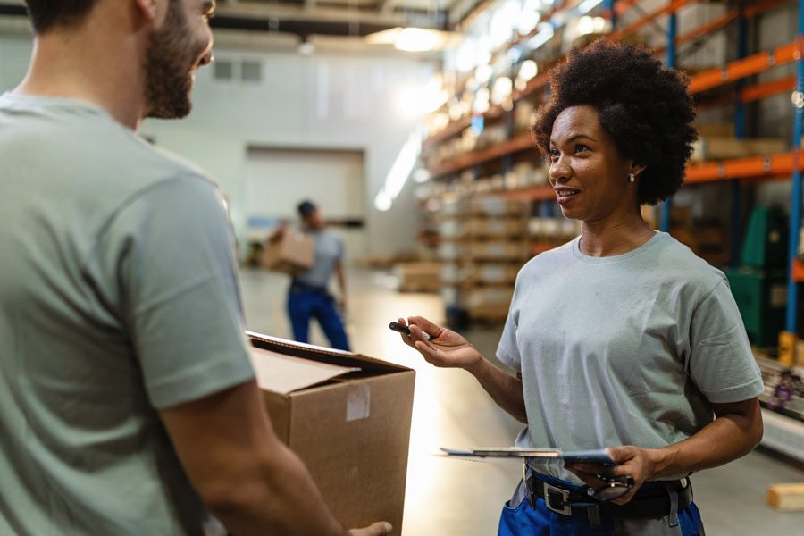 Workers Compensation Insurance - Warehouse Workers Moving Boxes