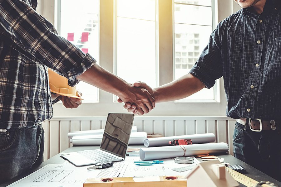 Specialized Business Insurance - Engineer and Contractor Shaking Hands on the Success of Their Project