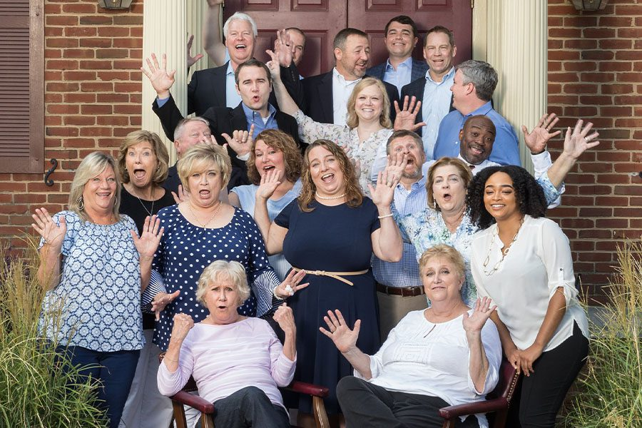 About Our Agency - Fun Group Photo of Manry Heston Team Standing in Front of Their Office Building in Tucker, Georgia