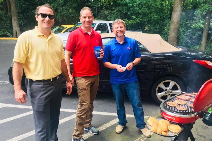 Meet the Team - Agency Owners Portrait Tailgating at their Annual Fourth of the July Party