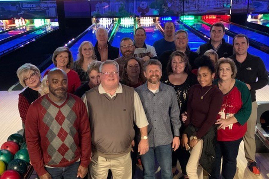 Meet the Team - Agency Owners and Comapny Team Portrait at a Bowling Alley Celebrating Their Christmas Party