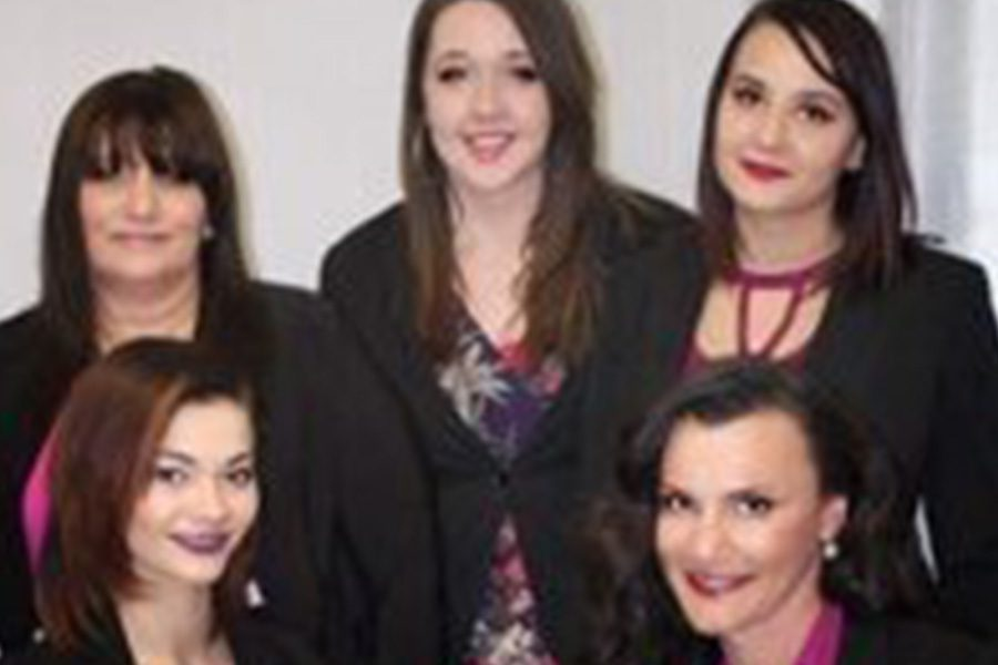 Homepage - Groupshot of the Arica Insurance Team Standing Together