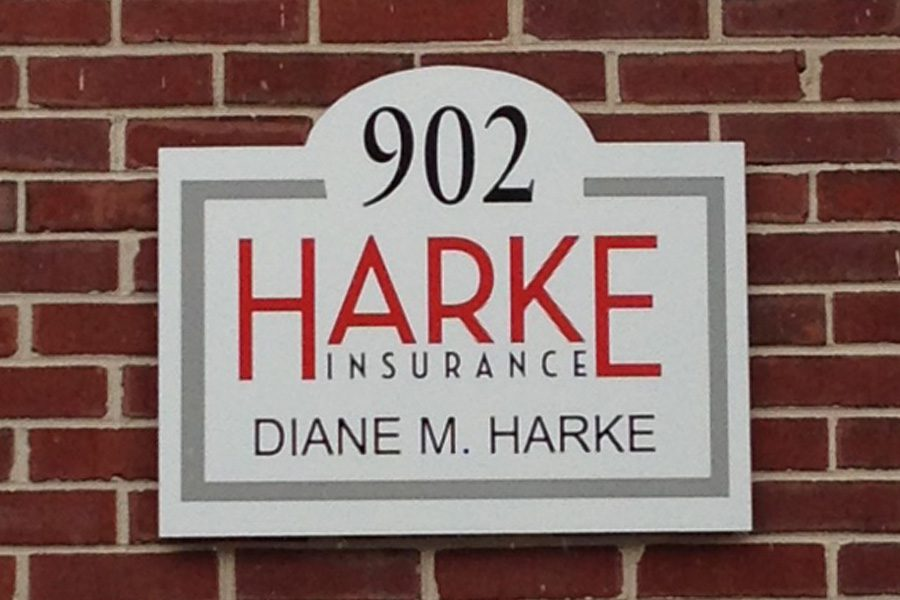About Our Agency - Close Up View of Signage of Harke Insurance Agency on Brick Wall