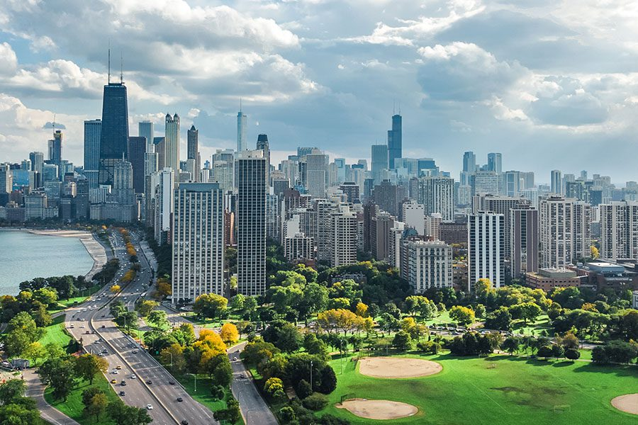 Contact - Aerial Drone View From Above of Lake Michigan and City of Chicago Downtown Skyscrapers Cityscape From Lincoln Park, Illinois