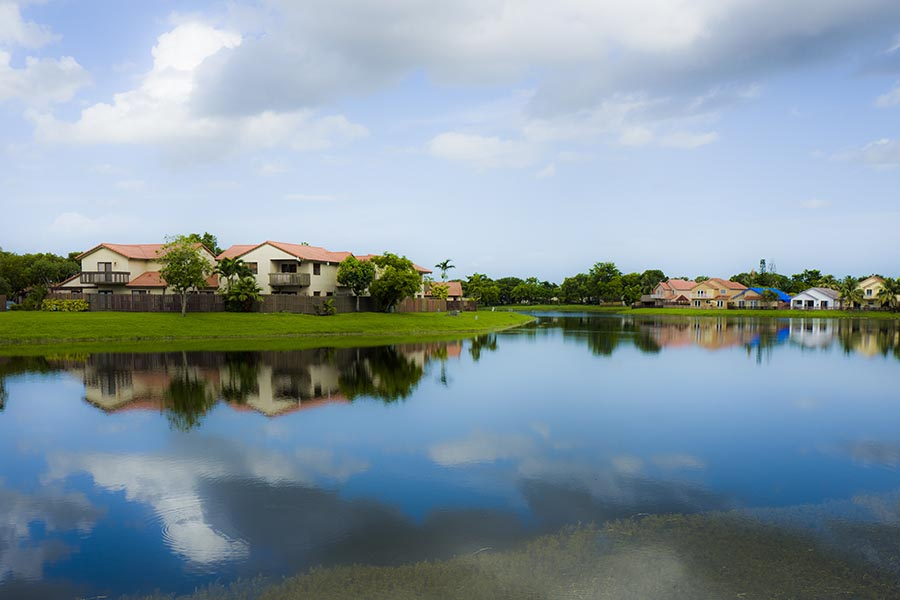 Kendall, FL Insurance - View Of a Neighborhood in Kendall, Florida, Homes With Terra Cotta Roofs and Palm Trees