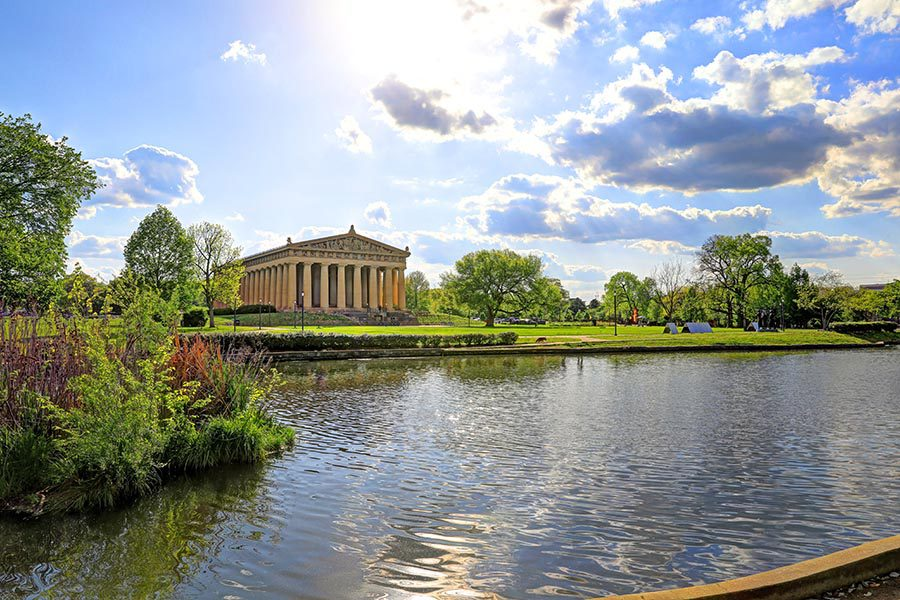 Contact Us - Nashville Parthenon in Centennial Park, Lake Watauga in the Foreground, Trees Along the Banks