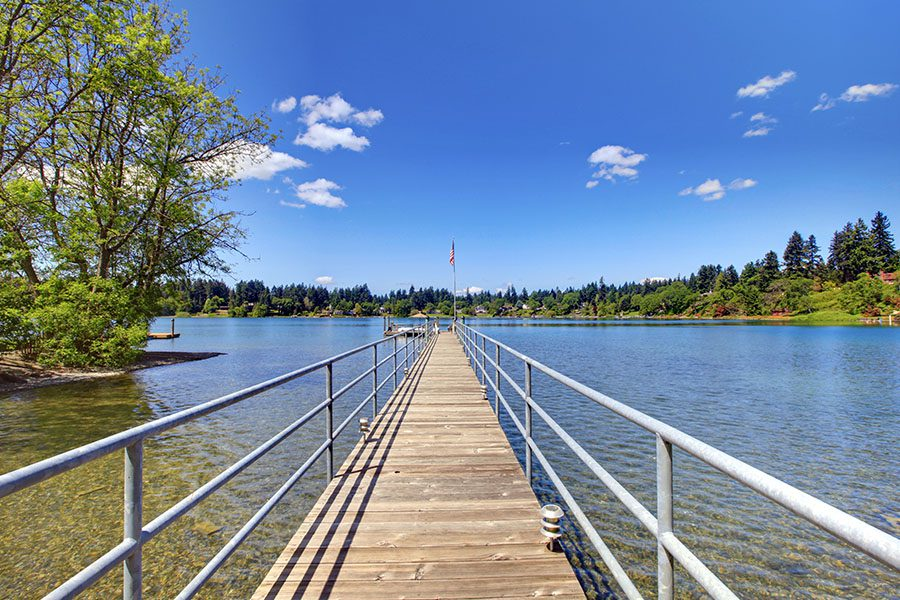 Lakewood, WA - View of Nature and Lake with Long Wood Pier on a Sunny Day