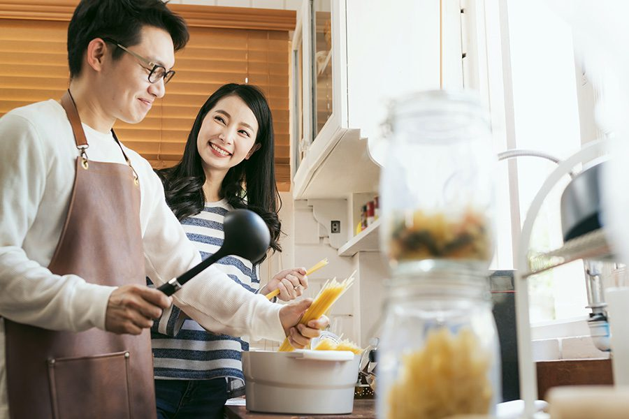 About Our Agency - Happy Married Couple Prepare and Cook food for Dinner Together at Home
