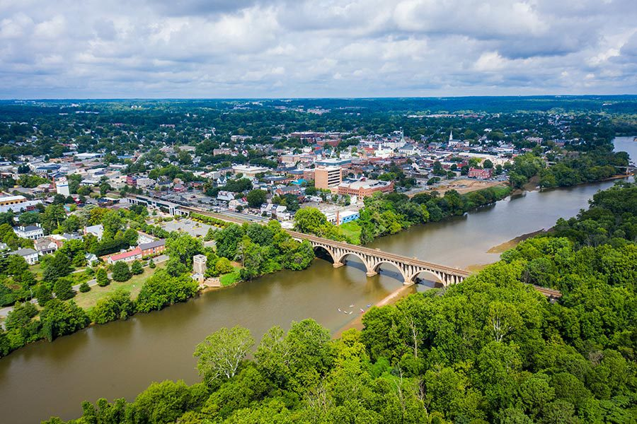 Fredericksburg, VA Insurance - Aerial View of Fredericksburg, Virginia on a Summer Day, River in the Foreground