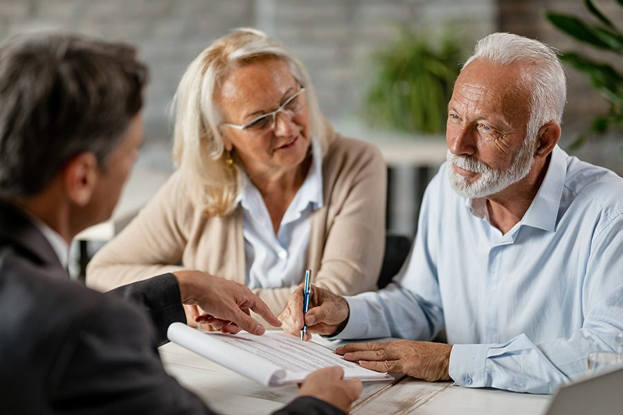 General Medicare - Couple Signing a Contract While Having a Meeting with an Insurance Agent in the Office