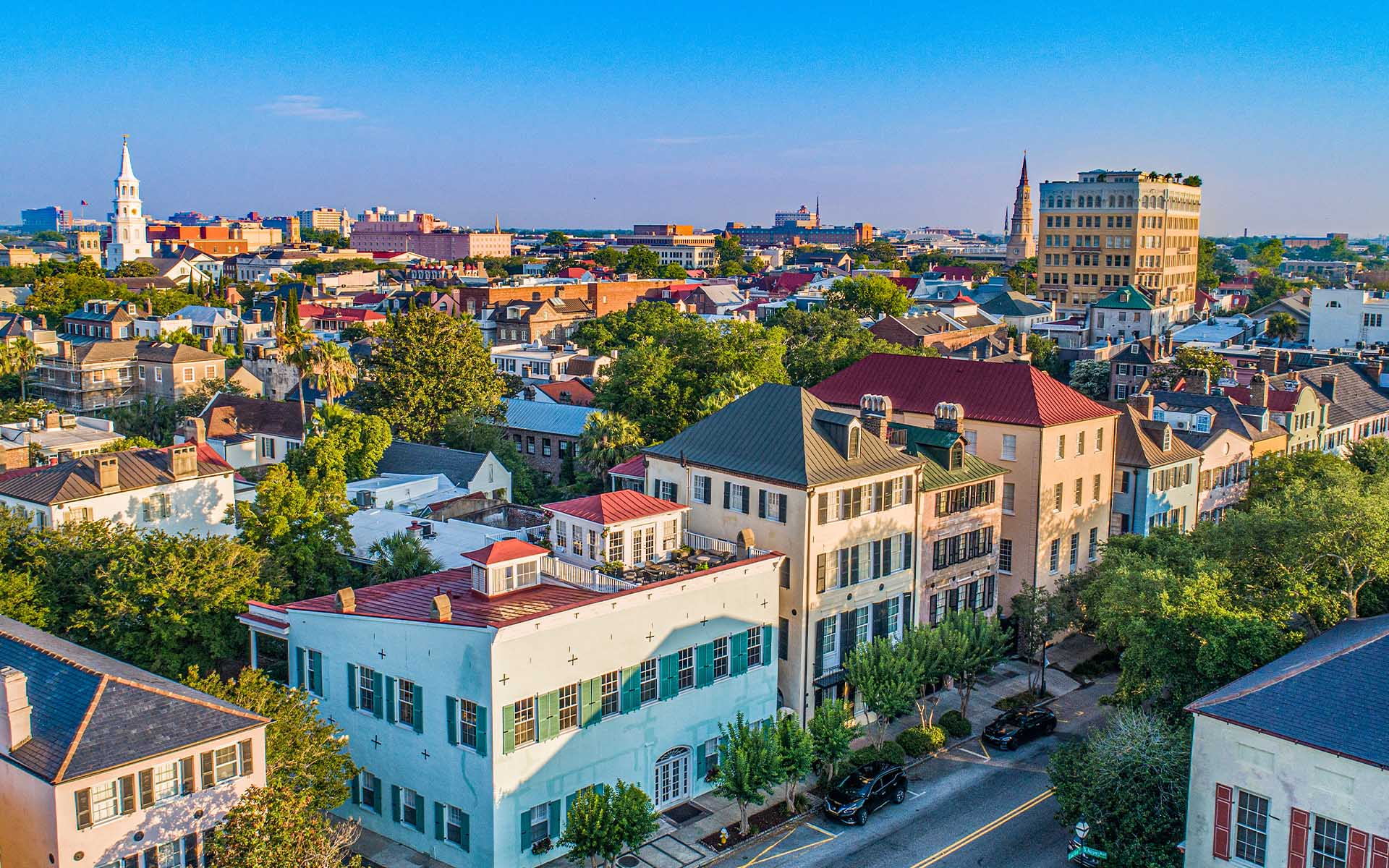 Homepage - Aerial View of City and Rainbow Row in Charleston, South Carolina at Sunset