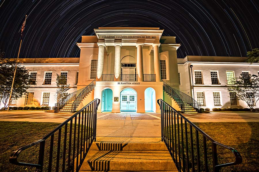 Walterboro, SC - View of the Town and Courthouse of Walterboro, South Carolina at Night with Star Trails in the Background