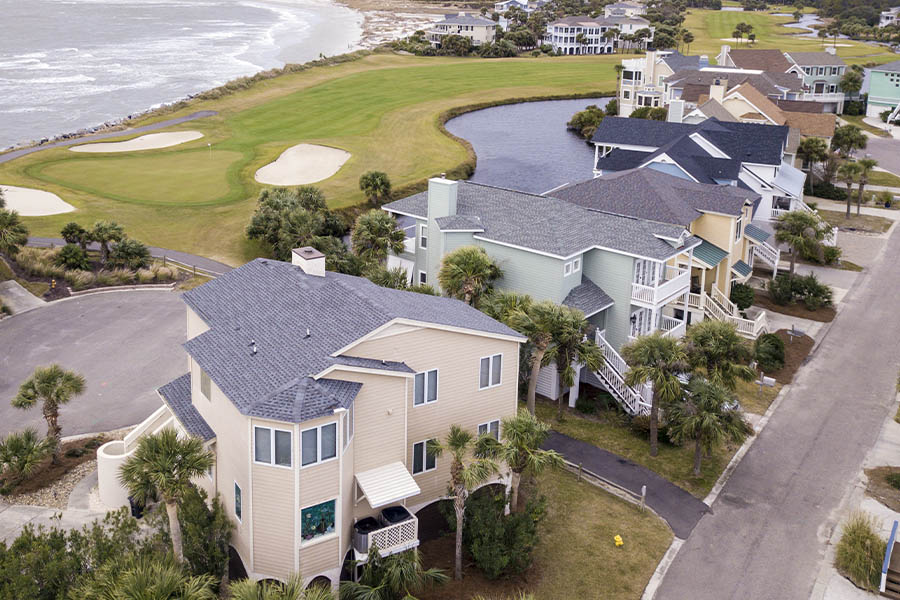 Coastal Insurance - Aerial View of Resort with Ocean View and Golf Course in South Carolina