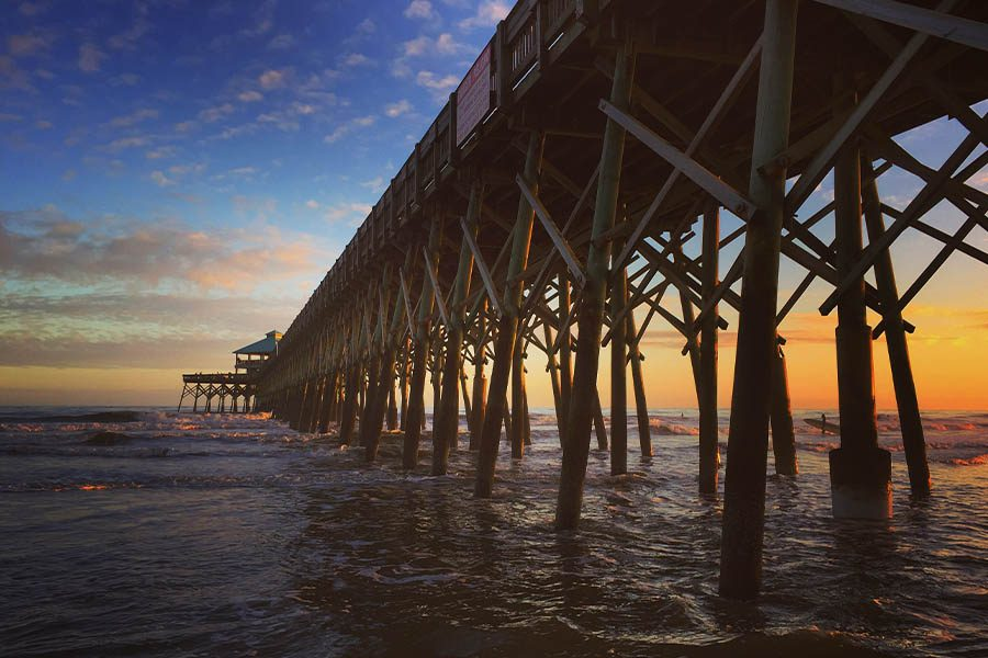 Homepage - Sunset Over Folly Beach Pier in Charleston County, South Carolina