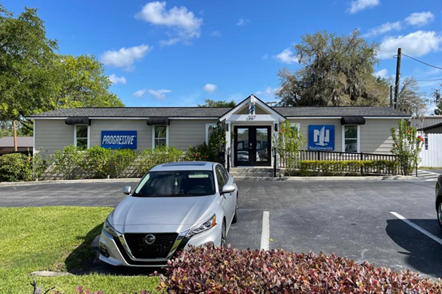 Contact - Office Location of Bill Lovell Insurance in Ocala, Florida, on a Sunny Day