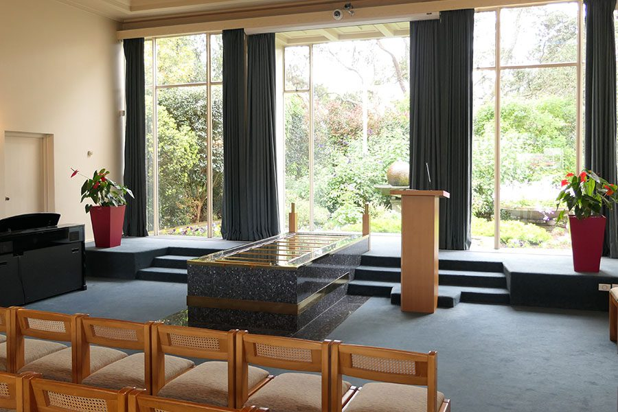 Funeral Home Insurance - View of the Funeral Home with the Sun Shining Through the Windows