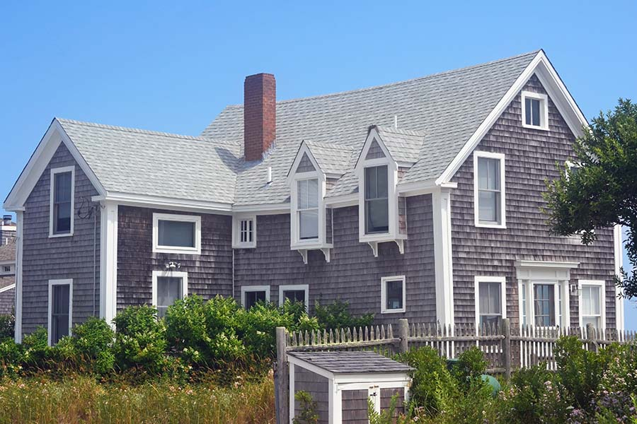 Insurance Quote - View of Three Story New England Cape Cod Home