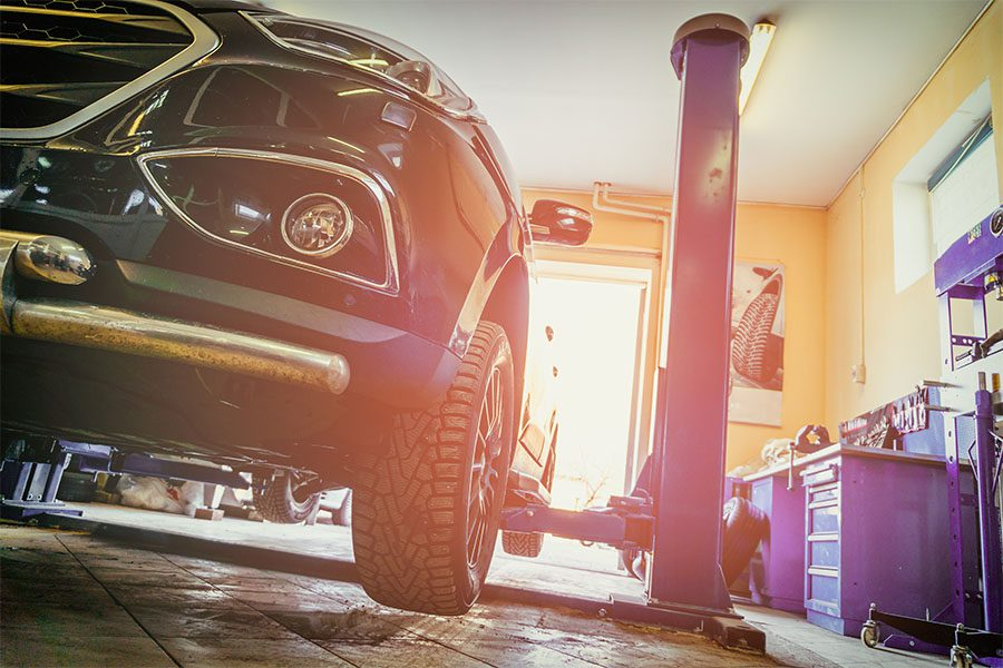 Specialized Business Insurance - View of a Car Being Repaired in a Auto Repair Shop with a Vintage Filter