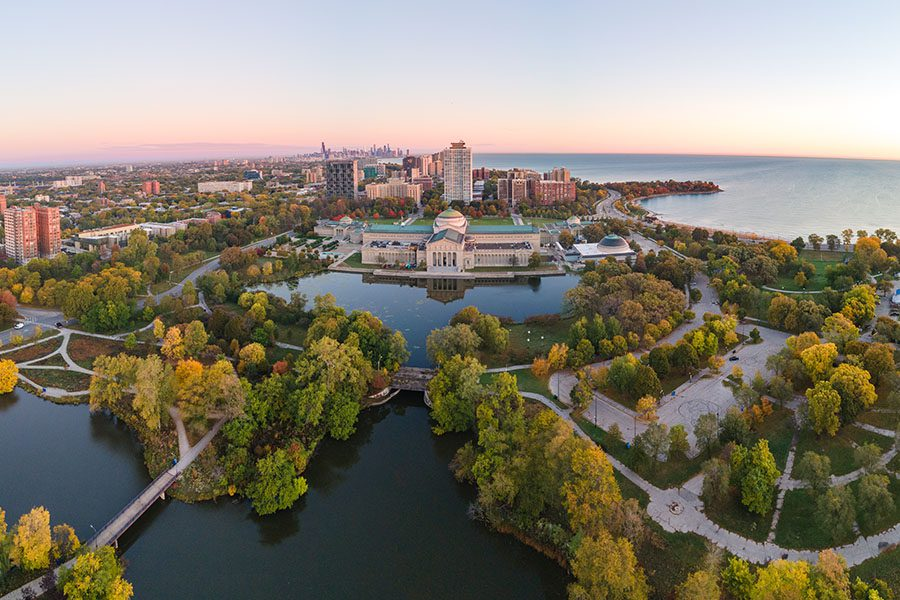 Northbrook, IL - Aerial View of Chicago Skyline Displaying Buildings and Trees With Many Bodies of Waters and a Great Lake