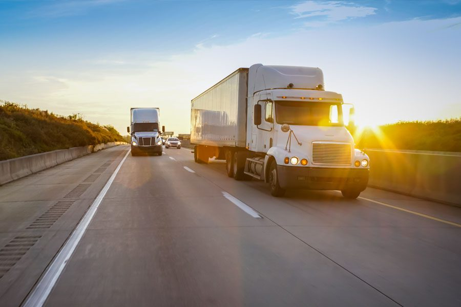 Trucking Insurance - Two Trucks Rolling Down the Highway