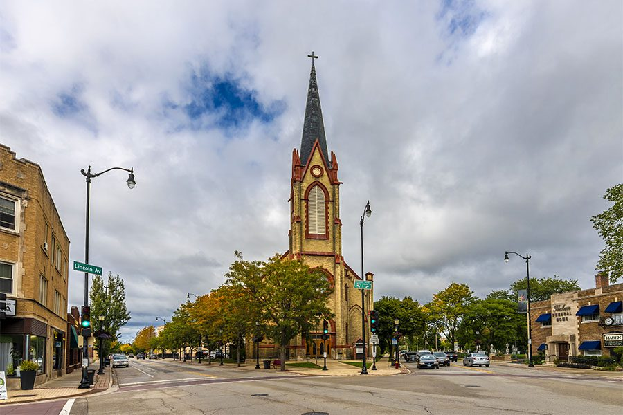 Skokie IL - View of Downtown Skokie Illinois on a Cloudy Day with Views of a Church and Surrounding Commercial Buildings