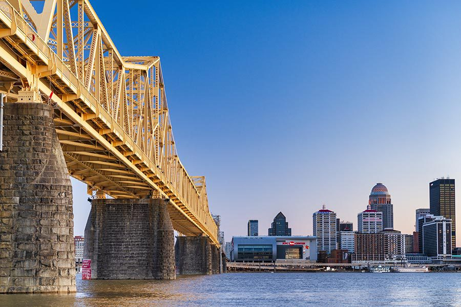 About Our Agency - View of Louisville from below a Yellow Bridge across the Ohio River