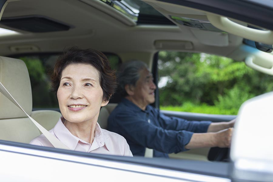 Client Center - Senior Couple Goes For a Drive, Wife Looking Out the Window Smiling
