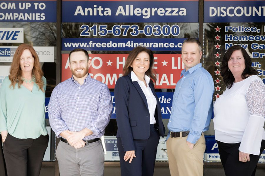 About Our Agency - Portrait of Freedom Insurance Group Team Members Standing Outside in Front of the Office Building