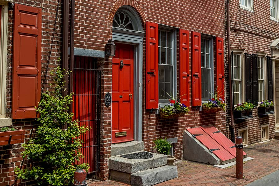 Client Center - Closeup View of a Colonial Brick Home in Historical Philadelphia on a Sunny Day