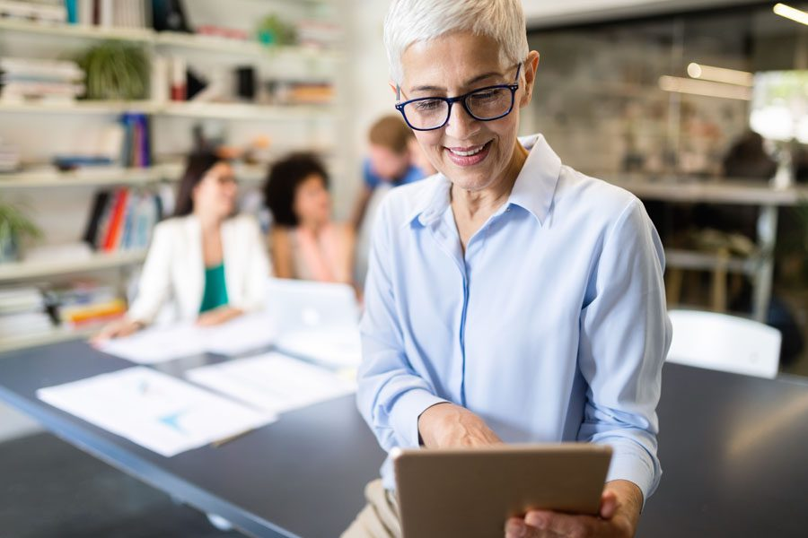 Business Owners Insurance - Business Owner Using Technology to Run Her Business
