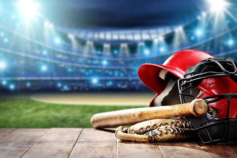 Blog - Closeup of Baseball Bat, Ball, And Glove in a Well Lit Stadium Image Graphic