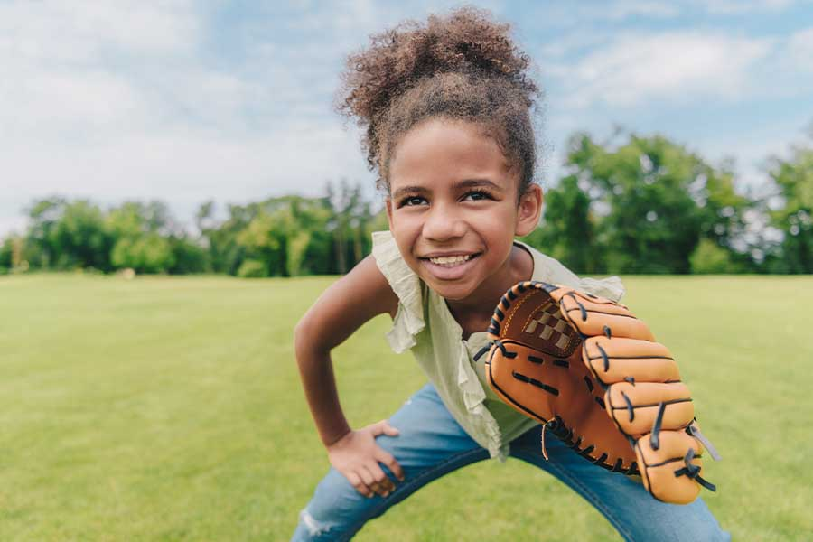 Contact - Young Girl Holding Baseball Glove and Playing Baseball with Her Family in a Park