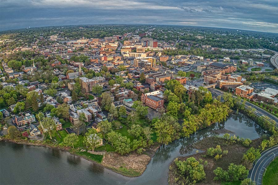 Elmira NY - Aerial View of the Small City of Elmira New York on a Sunny Day with Green Foliage