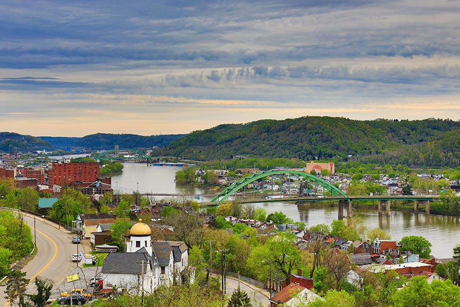 Contact - Aerial View of Wheeling, West Virginia Along the Ohio River With Skyline Cityscape Showing Wheeling Island in the Distance
