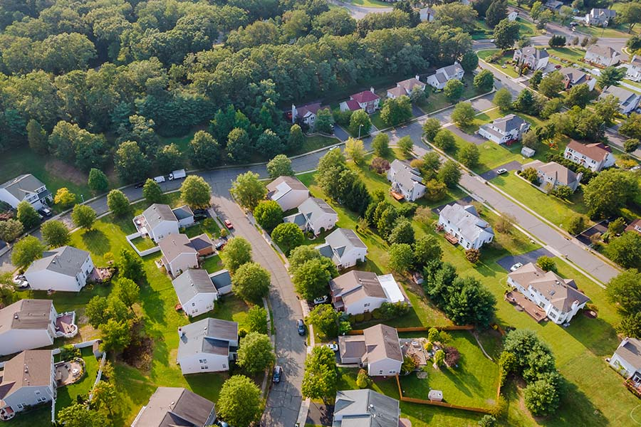 Lancaster, OH - Aerial View of a Small Town in the Countryside of Cleveland Displaying Houses and Trees