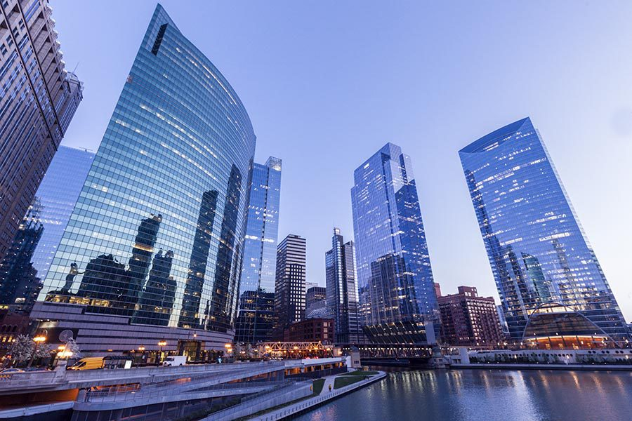 Contact - High Rises in Chicago at Dusk, Lit up for the Evening, Reflecting off the River