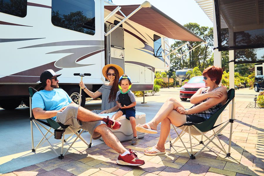 RV Insurance - Family Camped Outside Talking About the Vacation