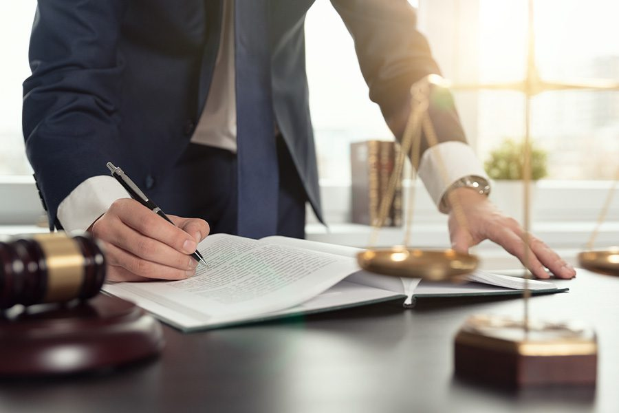 Legal Professional Insurance - Closeup of Lawyer Working with Sensitive Documents in an Office