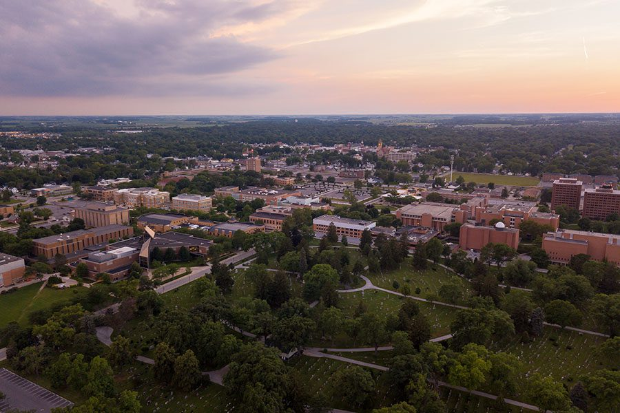 Bowling Green OH - Aerial View of the Town of Bowling Green in Ohio Surrounded by Green Foliage at Sunset