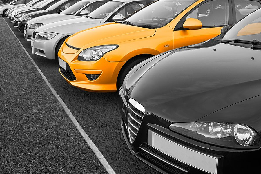 Blog - Angled View of a Fleet of New Business Cars With One of the Cars Being Yellow