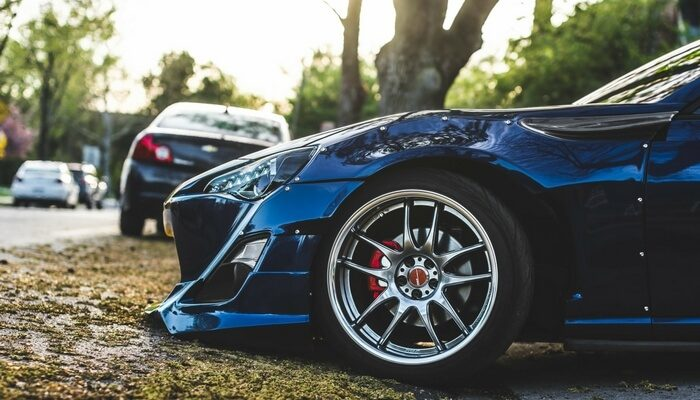 Blog - Roberti's Insurance Agency - How much Property Damage Liability Should I have? - Photo of Front of Sports Car Damaging Its Front on High Roadway
