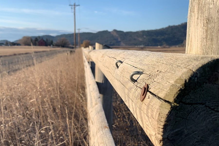 Insurance Quote - Closeup View of a Rustic Piece of Wooden Fence and Tall Grass During the Winter in Montana
