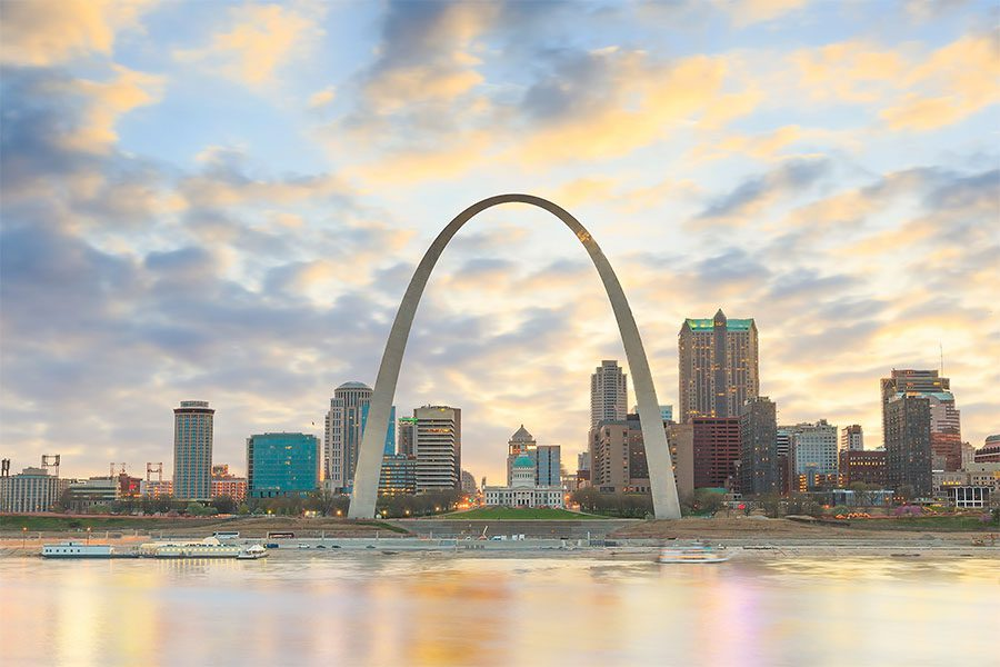 Contact - View of Modern Buildings and Landmarks in Downtown St. Louis Missouri Against a Colorful Sunset Sky