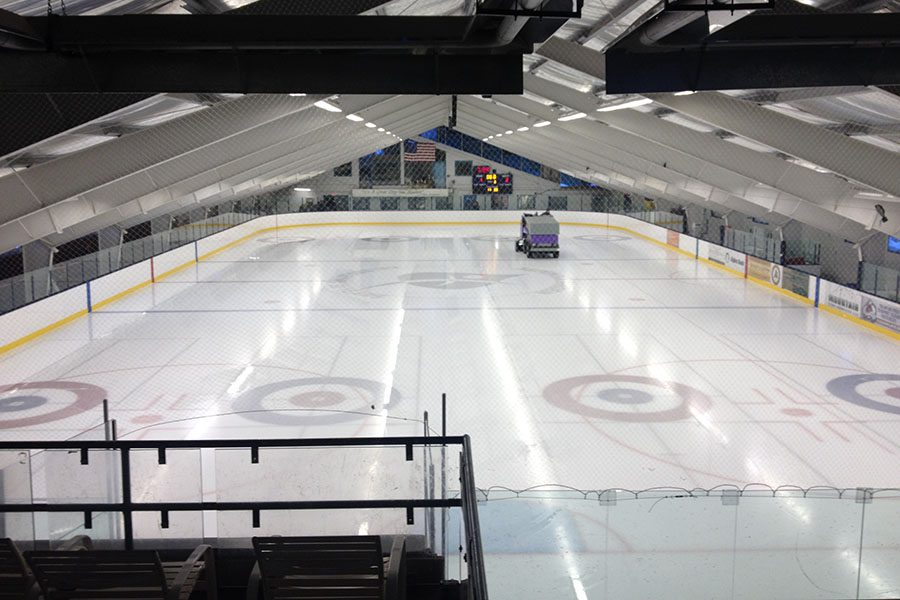 Specialized Business Insurance - View of an Empty Indoor Hockey Field with Bright Lights and an Ice Resurfacer