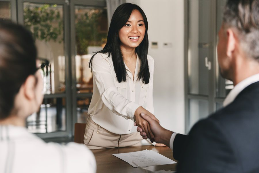 Employment Practice Liability Insurance - Woman Getting Hired for Her First Job
