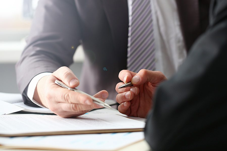 Probate Bonds - Fiduciary Agent and Beneficiary with Forms on a Clipboard and Silver Pen Closeup