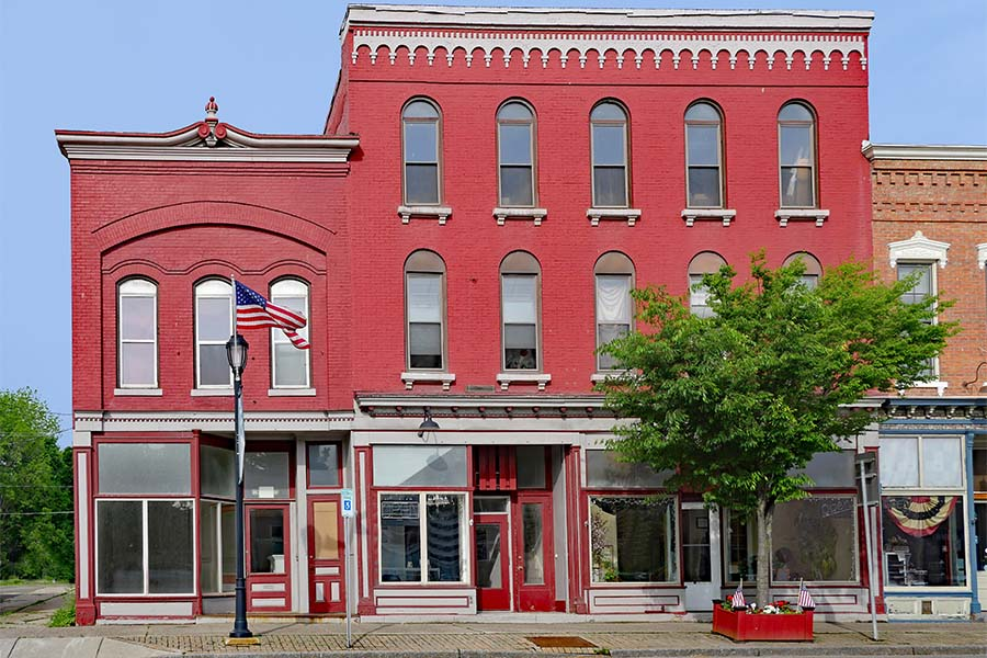 Business Insurance - View of Multiple Colorful Small Commercial Buildings Along the Main Street of a Small Town