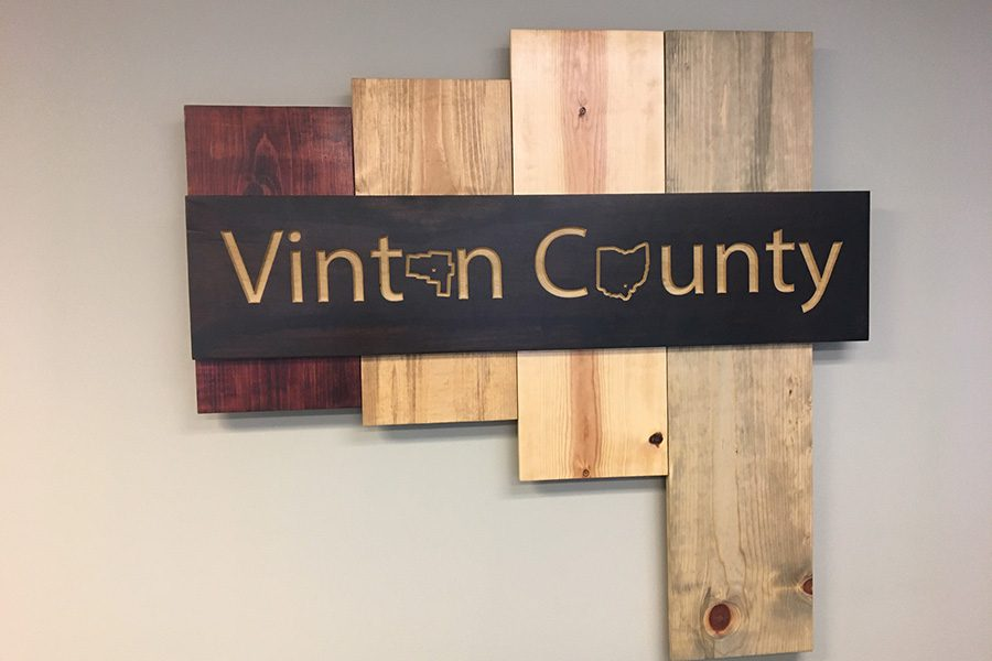 Community Involvement - Decorative Wooden Sign of Vinton County Ohio in the Booth Insurance Agency Office