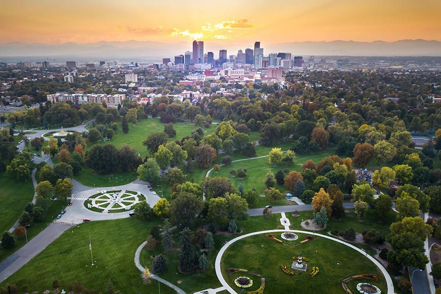 Contact - Denver, Colorado Skyline Seen From a Distance, Surrounding Suburbs and Parks in the Foreground