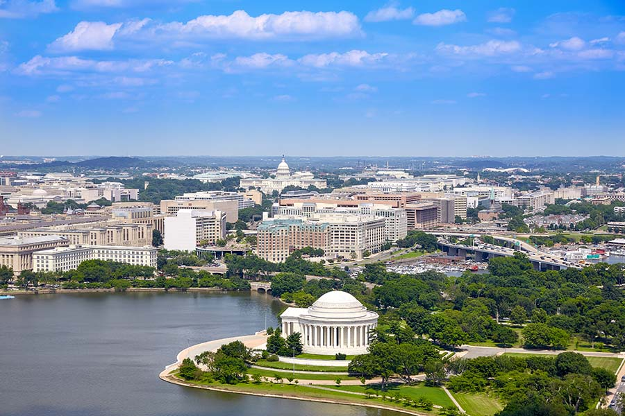 Contact - Aerial View Of Washington DC Against Blue Sky
